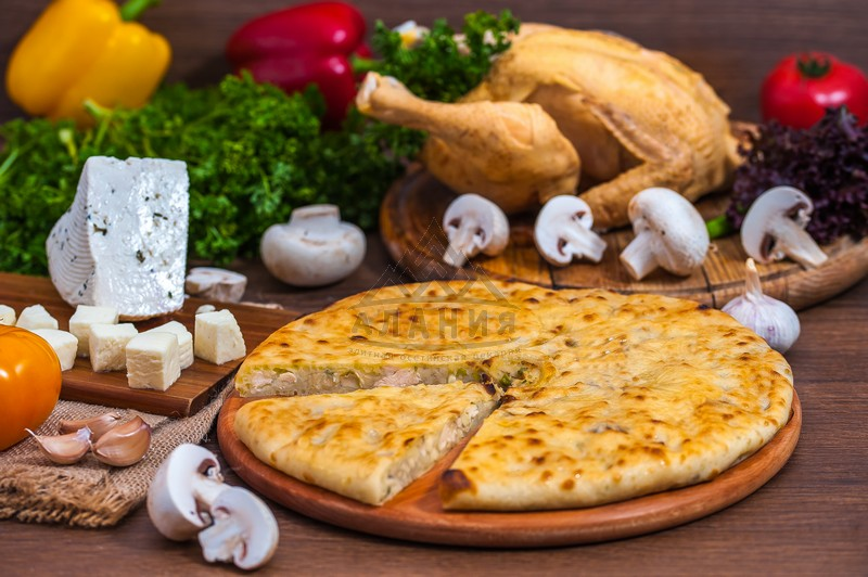Pie with fillet of homemade chicken, mushrooms, aged cheese and greens - alania.com.ua
